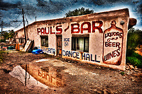 """Paul's Bar"" - New Mexico<br /> <br /> This photo was photographed in 2011 outside of Taos, New Mexico. I was on my way to Taos from Santa Fe to scout areas to photograph and immediately turned the car around to get a shot of this bar with tons of character. <br /> <br /> While the original photo was photographed in 2011, it wasn't until the Spring of 2012 when I processed and enhanced the original into what you see now.<br /> <br /> It was photographed hand-held with my Canon 5DII and 17-40mm lens. It is a single exposure image that I processed using Nik's HDR Efex Pro software as well as Color Efex Pro 4 (use coupon code mattsuess to save on Nik's plugins).<br /> <br /> l also used a photo texture from Flypaper Textures to complete the look."