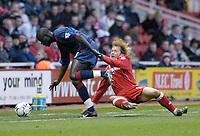 Photo. Glyn Thomas.<br /> Middlesbrough v Portsmouth. FA Barclaycard Premiership.<br /> Riverside Stadium, Middlesbrough. 06/12/2003.<br /> Boro's Gaizka Mendieta (R) is brought down by Amdy Faye.