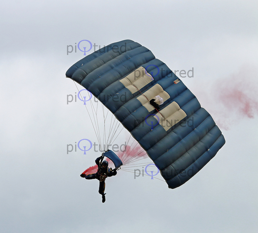 The Tigers Freefall Parachute Display team, Dunsfold Wheels & Wings, Dunsfold Park Airfield, Surrey UK, 23 August 2014, Photo by Richard Goldschmidt
