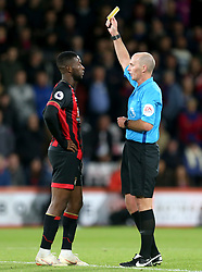 Bournemouth's Jefferson Lerma receives a yellow card from Referee Mike Dean