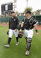 GLENDALE, ARIZONA - MARCH 02:  Carlos Rodon #55 and James McCann #33 of the Chicago White Sox walk in from the bullpen prior to the game against the Colorado Rockies on March 2, 2019 at Camelback Ranch in Glendale Arizona.  (Photo by Ron Vesely)  Subject:  Carlos Rodon; James McCann