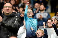 A young Swansea City fan celebrates at the final whistle as his team beat Everton 1-0.<br /> Premier league match, Swansea city v Everton at the Liberty Stadium in Swansea, South Wales on Saturday 6th May 2017.<br /> pic by  Phil Rees, Andrew Orchard sports photography.