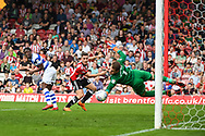 Brentford Forward Sergi Canos (47) takes a shot at goal and it is pushed away by Queens Park Rangers Goalkeeper Alex Smithies (1) during the EFL Sky Bet Championship match between Brentford and Queens Park Rangers at Griffin Park, London, England on 21 April 2018. Picture by Stephen Wright.