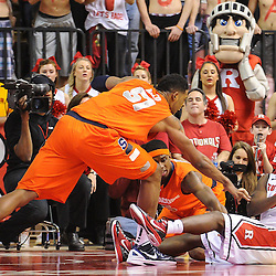 Rutgers Scarlet Knights guard Eli Carter (5) grabs a loose ball off the floor and passes away from Syracuse Orange center Fab Melo (51) during second half NCAA Big East basketball action between #2 Syracuse and Rutgers at the Louis Brown Athletic Center. Syracuse defeated Rutgers 74-64.