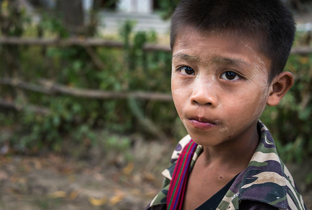 INLE LAKE, MYANMAR - CIRCA DECEMBER 2013: Boy in the Sankar village (or Samka ). A small village located in the south of Inle Lake.