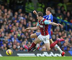 Burnley's Ashley Barnes and Chelsea's Nemanja Matic compete for the ball - Photo mandatory by-line: Mitchell Gunn/JMP - Mobile: 07966 386802 - 21/02/2015 - SPORT - Football - London - Stamford Bridge - Chelsea v Burnley - Barclays Premier League