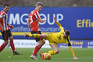 Sunderland midfielder Grant Leadbitter (23)  fouls Oxford United forward Gavin Whyte (16) during the EFL Sky Bet League 1 match between Oxford United and Sunderland at the Kassam Stadium, Oxford, England on 9 February 2019.