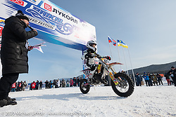 7-year old Silvia Pavlova on her Husqvarna TC50 at the Baikal Mile Ice Speed Festival opening ceremonies where participants on the big stage were introduced to the crowd one at a time. Maksimiha, Siberia, Russia. Saturday, February 29, 2020. Photography ©2020 Michael Lichter.