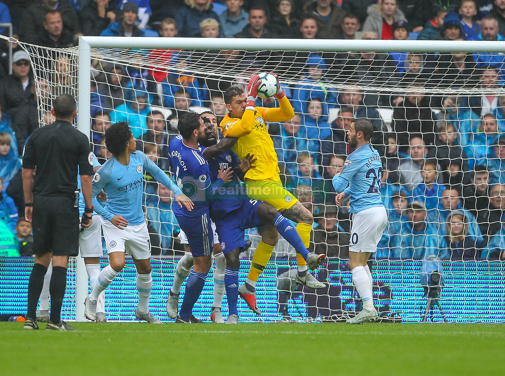 September 22, 2018 - Cardiff City, England, United Kingdom - Ederson of Manchester City and Bruno Ecuele Manga of Cardiff City challenge for the ball during the Premier League match between Cardiff City and Manchester City at Cardiff City Stadium,  Cardiff, England on 22 Sept 2018. (Credit Image: © Action Foto Sport/NurPhoto/ZUMA Press)