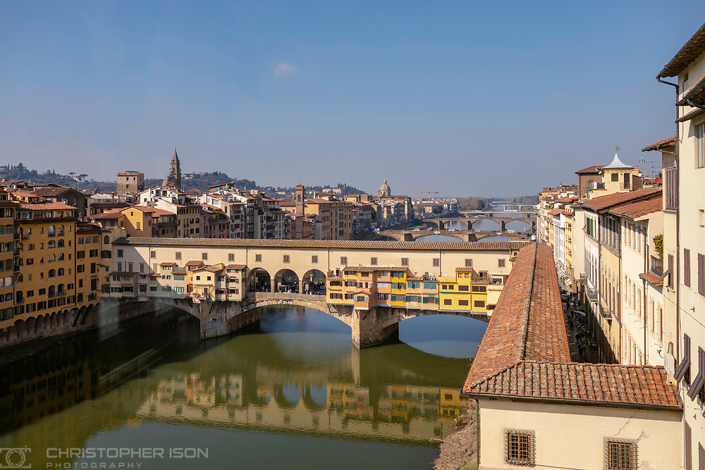 The Ponte Vecchio and the Corridoio Vasariano over the river Arno in Florence, Tuscany, Italy seen from the first floor of the Ufizzi Gallery.<br /> Picture date: Sunday February 24, 2019.<br /> Photograph by Christopher Ison ©<br /> 07544044177<br /> chris@christopherison.com<br /> www.christopherison.com