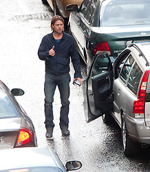 """A police motorbike smashes the wing mirror of the car carrying Brad Pitt on the set of the movie """"World War Z"""" being shot in the city centre of Glasgow. The film, which is set in Philadelphia, is being shot in various parts of the Glasgow, transforming it to shoot the post apocalyptic zombie film..© pic : Michael Schofield."""