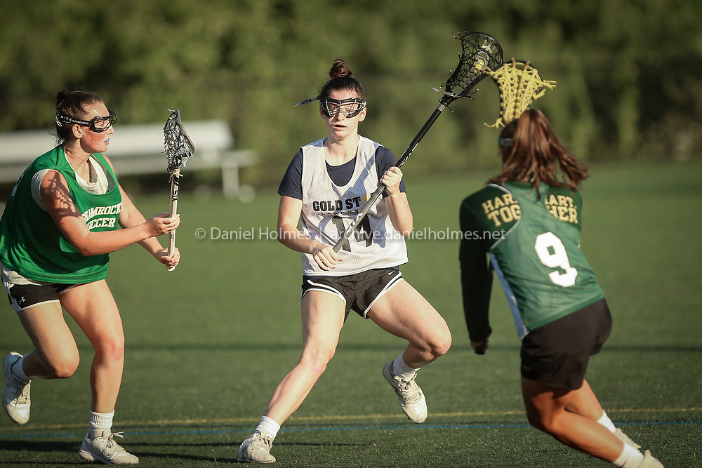 Franklin's Jill Fennerty looks for an open teammate during the Gold Star Lacrosse league match against Bishop Feehan at Medway High School, on Jul. 27, 2020. [Daily News and Wicked Local Photo/Dan Holmes]