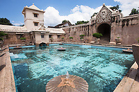 Taman Sari is a site of a former royal garden of the Sultanate of Yogyakarta and was built in the mid 18th century.  Today only the central bathing complex is left intact, while the other areas have been occupied by local settlers.  Umbul Pasiraman (also known as Umbul Binangun or Umbul Winangun) is a bathing complex for the royal family. The bathing complex is an enclosed space surrounded by the northern building which was used as a resting place and changing room for the daughters and concubines of the sultan. On the south side of this building is the Umbul Muncar pool.  The building to the south is a building with a tower in its center - one wing of the building was used as the sultan's changing room.  The central tower was used by the sultan to observe his daughters and concubines bathing in the pool.  During its heyday, only females and the sultan were allowed to enter this bathing complex.