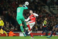 Goalkeeper Alphonse Areola of Paris Saint-Germain punches the ball away and over Carl Jenkinson of Arsenal. UEFA Champions league group A match, Arsenal v Paris Saint Germain at the Emirates Stadium in London on Wednesday 23rd November 2016.<br /> pic by John Patrick Fletcher, Andrew Orchard sports photography.
