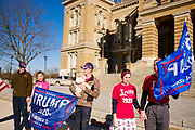 """28 NOVEMBER 2020 - DES MOINES, IOWA: People in front of the Iowa State Capitol during the """"Stop the Steal"""" rally at the Iowa State Capitol Saturday. About 30 supporters of US President Donald Trump gathered at the Iowa State Capitol to rally in support of the President and in opposition to the outcome of the US election. They are a part of the """"Stop the Steal"""" movement which has spread across the US. This is the fourth week that there have been """"Stop the Steal"""" rallies at state capitols across the US. Most independent observers and election officials, both Republican and Democratic, have said the election was free and fair and that there was no election of fraud.          PHOTO BY JACK KURTZ"""