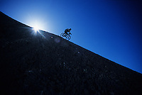 A young man freeride mountain biking in Cainville, Utah.