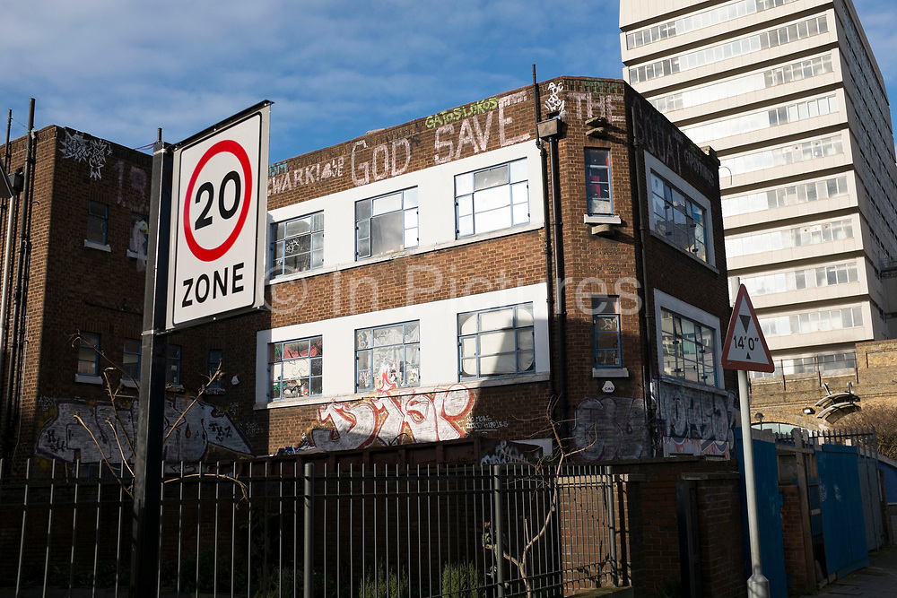 God Save The Squat. An old workers building which has been inhabited by squatters for many years in Southwark, London, UK.