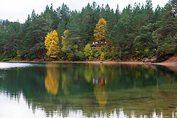 Autumn view of An Lochan Uaine more commonly known as the Green Loch due to the striking green colour of it's water in Cairngorms National Park Scotland, UK
