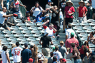 A fan grabs an Addison Russell home run ball in center field during the Angels' preseason game against the Chicago Cubs at Angel Stadium Sunday.<br /> <br /> <br /> ///ADDITIONAL INFO:   <br /> <br /> angels.0404.kjs  ---  Photo by KEVIN SULLIVAN / Orange County Register  --  4/3/16<br /> <br /> The Los Angeles Angels take on the Chicago Cubs at Angel Stadium during a preseason game at Angel Stadium Sunday.<br /> <br /> <br />  4/3/16