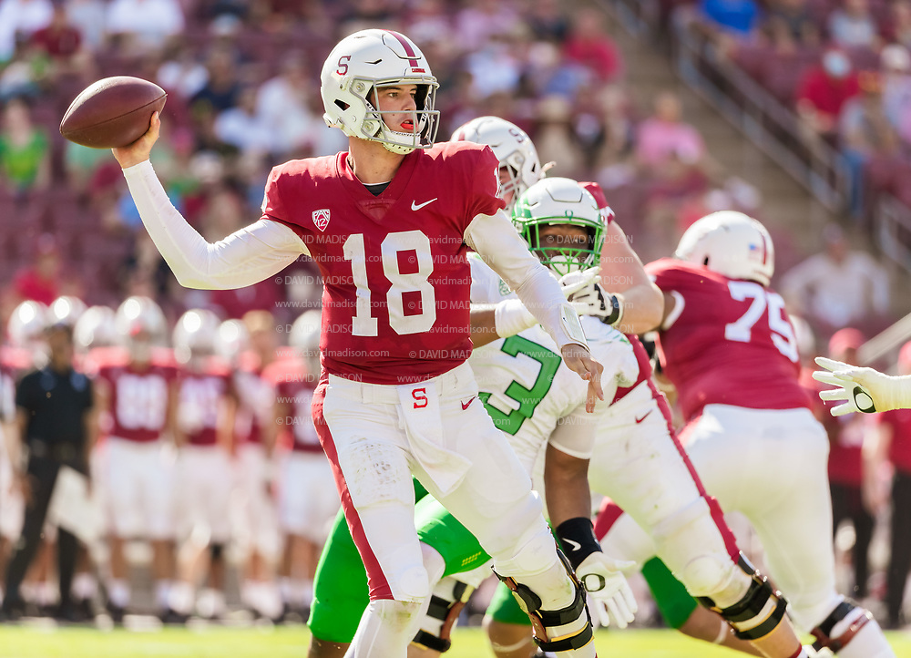 PALO ALTO, CA - OCTOBER 2:  Tanner McKee #18 of the Stanford Cardinal attempts a pass during an NCAA Pac-12 college football game against the Oregon Ducks on October 2, 2021 at Stanford Stadium in Palo Alto, California; also visible is Brandon Dorius #3 of Oregon.  (Photo by David Madison/Getty Images)