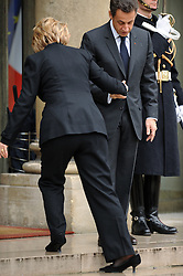 Secretary of State Hillary Clinton drops a shoe as she's greeted by president Nicolas Sarkozy for a bilateral meeting at the Elysee Palace in Paris, France on January 29, 2010. Photo by Thierry Orban/ABACAPRESS.COM