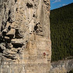 Cory Rogans sport climbing at Moose Mountain in Bragg Creek, Kananaskis, Alberta, Canada