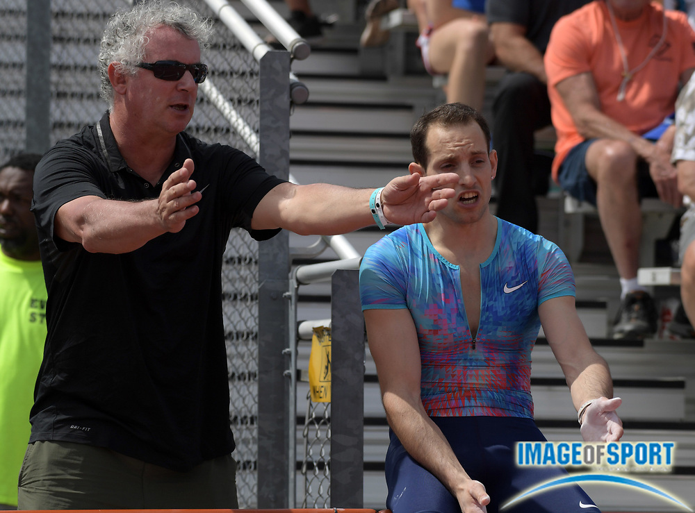 Mar 31, 2018; Austin, TX, USA; Renaud Lavillenie talks with coach Philippe D'Encausse during the pole vault at the 91st Clyde Littlefield Texas Relays at Mike A. Myers Stadium.