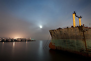 The ghost ships of Mothball Fleet: Incredible pictures of abandoned Navy war ships taken by crew of illegal squatters<br /> <br /> They are the Navy ships that heroically fought in World War Two, now slowly rotting in a San Francisco bay.<br /> And as they are being towed, one by one, for scrapping, in just a few years they will all be gone.<br /> A group of illegal squatters gained unprecedented access to the vessels by rowing at night for two years past security and climbing onto the ships, sleeping secretly on board for days at a time.<br /> And as these stunning images show, their efforts were certainly worth it.<br /> The ships, which served the U.S. in four wars - World War Two, the Korean War, the Vietnam War and Desert Storm - are now stationed in Suisun Bay, 30 miles north east of San Francisco.<br /> The mothballed ships, which once numbered close to 400, have been out of action for a decade. 15 of the ships have already been scrapped and the whole fleet is expected to have disappeared by 2017.<br /> <br /> <br /> The squatting photographers, led by Scott Haefner, gained access to the ships over a two year period.<br /> They took months to prepare their voyages - analysing tidal patterns and security rotas - but despite many close calls managed to spend many days at a time on board.<br /> 'As news began to mount that the ships would finally be towed out for scrapping, we knew we had to act fast if we wanted to explore and document them,' Haefner said.<br /> <br /> <br /> 'We had fantasised for years about getting aboard and had to overcome numerous obstacles just to get to the ships. To get across the channel, we acquired a small, inflatable raft that was just big enough for the three of us and our gear, along with a small motor powered by a car battery.' <br /> The raft often had holes in and on one occasion they frantically had to keep pumping up the boat while still on water.<br /> 'On subsequent trips, we spent the entire weekend aboard the ships, each