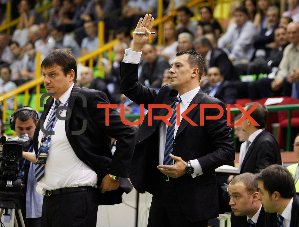 Efes Pilsen's coach Ergin ATAMAN (L) and co trainer Ufuk SARICA (R) during their Turkish Basketball league Play Off Final first leg match Efes Pilsen between Fenerbahce Ulker at the Ayhan Sahenk Arena in Istanbul Turkey on Thursday 20 May 2010. Photo by Aykut AKICI/TURKPIX