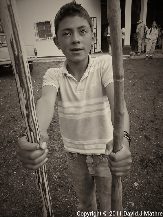 Waking Stick Vendor in San Francisco de Sales..  Pacaya Volcano National Park. Image taken with a Leica V-Lux 20 (ISO 800, 4 mm, f/4, 1/160 sec). Raw image processed and converted to B&W with Capture One Pro and Photoshop CS5. .