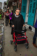 Woman masked as Supreme Court Judge Ruth Bader Ginsburg in the Society of Saint Anne parade during Mardi Gras on 25th February 2020 in Bywater district of New Orleans, Louisiana, United States. Mardi Gras is the biggest celebration the city of New Orleans hosts every year. The magnificent, costumed, beaded and feathered party is laced with tradition and  having a good time. Celebrations are concentrated for about two weeks before and culminate on Fat Tuesday the day before Ash Wednesday and Lent.