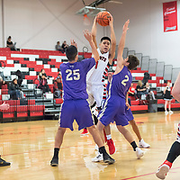 Adam Garcia (1) of Grants looks to pass with heavy defending from Jaxon Manning (25) and Dallin Mangelson (2) of Kirtland Central at the Eddie Pena Classic in Grants on Saturday. Grants won 60-42.