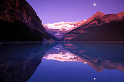 Dawn light on Mount Victoria reflected in Lake Louise, Banff National Park, Alberta, Canada