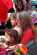 Family ages 42 and 6 at Cinco de Mayo festival.  St Paul Minnesota USA