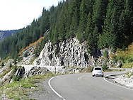 A vehicle travels up the Stevens Canyon road in Mount Rainier National Park, WA, USA