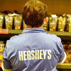 Hershey, PA, USA - November 26, 2019: A Hershey's worker busily works on the inventory on sale at Hershey's Chocolate World.