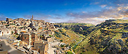 """Panoramic ew of """"la Gravina"""" ravine and the Sassi of Matera, Basilicata, Italy. A UNESCO World Heritage site.<br /> <br /> The area of Matera has been occupied since the Palaeolithic (10th millennium BC) making it one of the oldest continually inhabited settlements in the world. <br /> The town of Matera was founded by the Roman Lucius Caecilius Metellus in 251 BC and remained a Roman town until  was conquered by the Lombards In AD 664 becoming part of the Duchy of Benevento.  Matera was subject to the power struggles of southern Italy coming under the rule of the Byzantine Roman, the Germans and finally Matera was ruled by the Normans from 1043 until the Aragonese took possession in the 15th century. <br /> <br /> At the ancient heart of Matera are cave dwellings known as Sassi. As the fortunes of Matera failed the sassy became slum dwelling and the appalling living conditions became be the disgrace of Italy. From the 1970's families were forcibly removed from the Sassi and rehoused in the new town of Matera. Today tourism has regenerated Matera and the sassi have been modernised and are lived in again making them probably the longest inhabited houses in the world dating back 9000 years."""