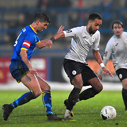 TELFORD COPYRIGHT MIKE SHERIDAN Brendon Daniels of Telford holds off David Lynch during the Vanarama Conference North fixture between AFC Telford United and Alfreton Town at the New Bucks Head Stadium on Thursday, December 26, 2019.<br /> <br /> Picture credit: Mike Sheridan/Ultrapress<br /> <br /> MS201920-036