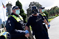 MELBOURNE, VIC - SEPTEMBER 05: A man wearing a Darth Vader mask is taken into custody during the Anti-Lockdown Protest on September 05, 2020 in Melbourne, Australia. Stage 4 restrictions are in place from 6pm on Sunday 2 August for metropolitan Melbourne. This includes a curfew from 8pm to 5am every evening. During this time people are only allowed to leave their house for work, and essential health, care or safety reasons. (Photo by Mikko Robles/Speed Media)