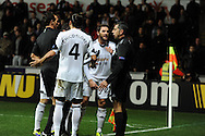 Swansea city players inc Angel Rangel © and Chico Flores plead to the assistant ref after their 1st half goal was disallowed. UEFA Europa league match, Swansea city v Valencia at the Liberty Stadium in Swansea on Thursday 28th November 2013. pic by Andrew Orchard, Andrew Orchard sports photography,