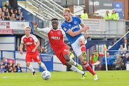 Portsmouth Defender, Matt Clarke (5) and Fleetwood Town Forward, Devante Cole (44) challenge for the ball during the EFL Sky Bet League 1 match between Portsmouth and Fleetwood Town at Fratton Park, Portsmouth, England on 16 September 2017. Photo by Adam Rivers.