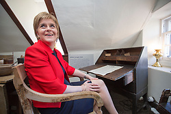 SNP Leader Nicola Sturgeon sits in Andrew Carnegie's chair on a visit to the Andrew Carnegie Birthplace Museum in Dunfermline today.