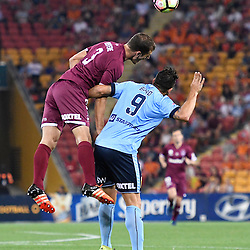 BRISBANE, AUSTRALIA - NOVEMBER 19: Luke DeVere of the Roar heads the ball over Bobo of Sydney during the round 7 Hyundai A-League match between the Brisbane Roar and Sydney FC at Suncorp Stadium on November 19, 2016 in Brisbane, Australia. (Photo by Patrick Kearney/Brisbane Roar)