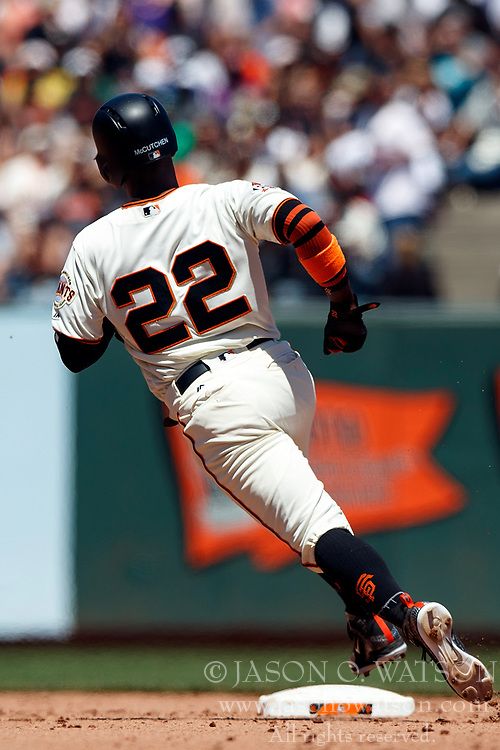 SAN FRANCISCO, CA - JULY 15: Andrew McCutchen #22 of the San Francisco Giants rounds second base against the Oakland Athletics during the fourth inning at AT&T Park on July 15, 2018 in San Francisco, California. The Oakland Athletics defeated the San Francisco Giants 6-2. (Photo by Jason O. Watson/Getty Images) *** Local Caption *** Andrew McCutchen