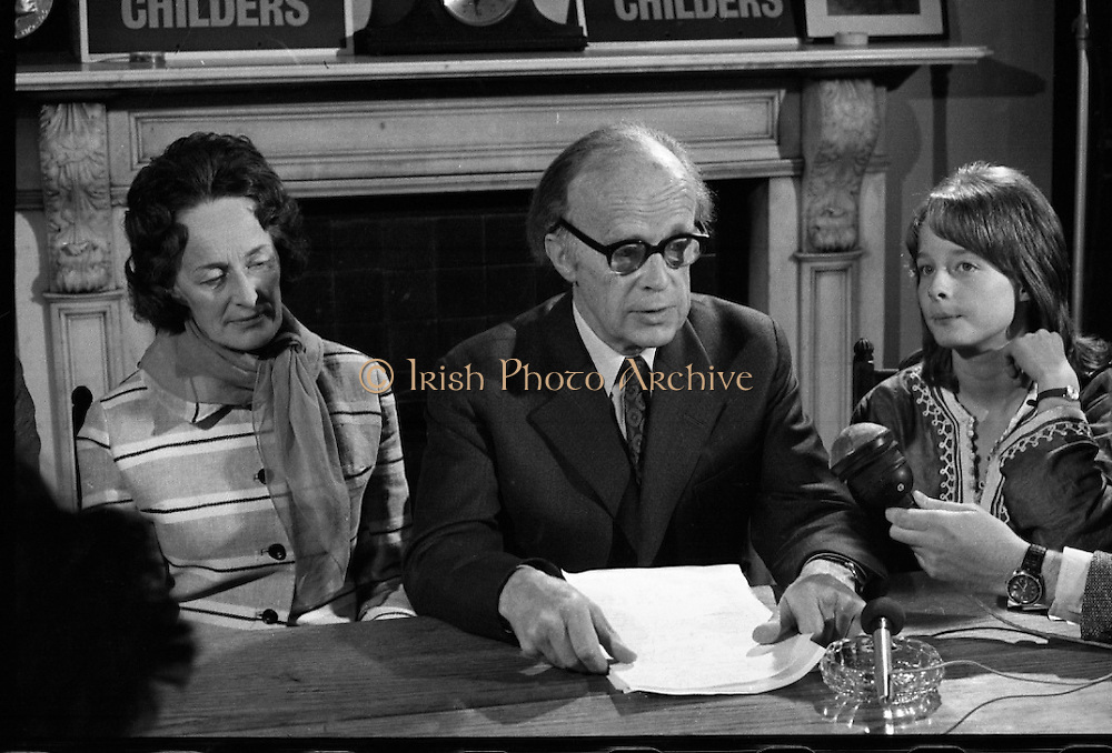 Erskine Childers Press Conference..1973..31.05.1973..05.31.1973..31st May 1973..At a press conference at Fianna Fail headquarters, Mr Erskine Childers, was confirmed as the winner of the presidential campaign. He won by a margin of 52% to 48% beating the favourite Tom O'Higgins,Fine Gael..Pictured at the press conference in Fianna Fail headquarters was President elect, Erskine Childers, He is flanked by his wife,Rita and daughter Nessa as he reads a statement of acceptance.