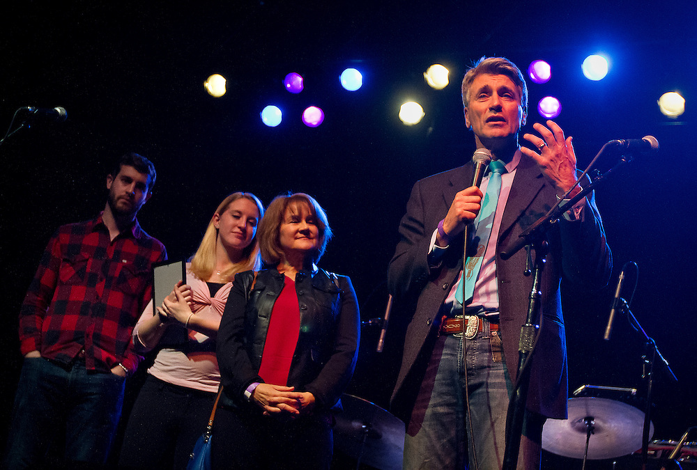 """Minneapolis Mayor R.T. Rybak, right, speaks to the audience during his """"Unauguration Party"""" at First Avenue, Wednesday, December 18, 2013. Alongside Rybak are, right to left, his wife Megan O'Hara, daughter Gracie, and son Charlie."""