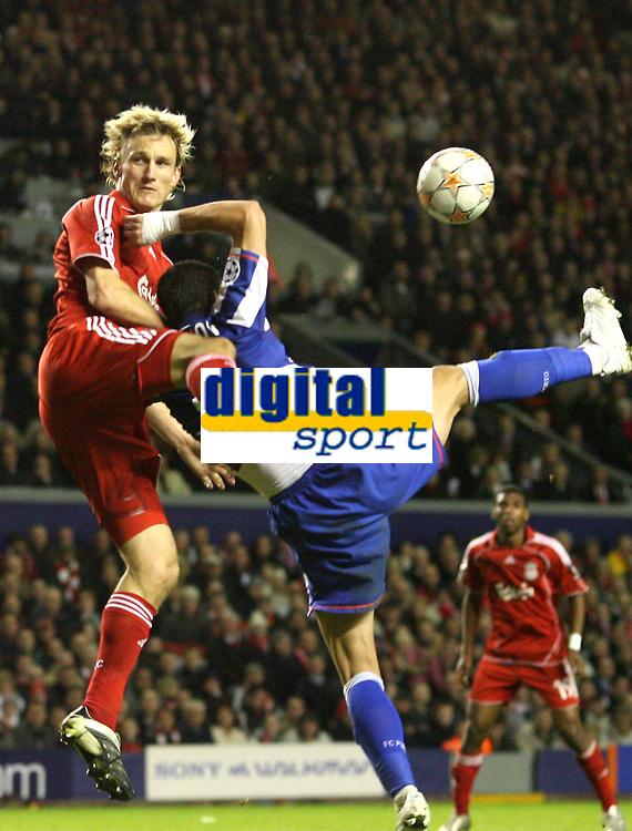 Photo: Paul Greenwood/Sportsbeat Images.<br />Liverpool v Porto. UEFA Champions League. 28/11/2007.<br />Porto's Milan Stepanov handballs in the area under pressure from Liverpool's Sami Hypia