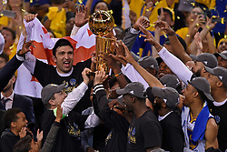 The Golden State Warriors celebrate as they hold the championship trophy after defeating the Cleveland Cavaliers, 129-120, in Game 5 of the NBA Finals at Oracle Arena in Oakland, Calif., on Monday, June 12, 2017. (Photo by Jose Carlos Fajardo/Bay Area News Group/TNS) *** Please Use Credit from Credit Field ***