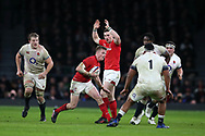 Gareth Anscombe of Wales runs past Mako Vunipola of England (1). England v Wales, NatWest 6 nations 2018 championship match at Twickenham Stadium in Middlesex, England on Saturday 10th February 2018.<br /> pic by Andrew Orchard, Andrew Orchard sports photography