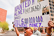 23 APRIL 2011 - PHOENIX, AZ: A man carries a sign calling for the arrest of Maricopa County Sheriff Joe Arpaio during an immigration march in Phoenix Saturday. Arpaio has conducted crime sweeps in Hispanic neighborhoods that his critics say unfairly target Latinos and is accused of misspending nearly 100 million dollars of taxpayer money. About 500 immigrants' rights supporters marched through Phoenix, AZ, Saturday, April 23 to protest the first anniversary of SB1070, Arizona's tough anti-immigrant law. The law was signed by Gov Jan Brewer on April 23, 2010. The federal courts have blocked implentation of the law on constitutional grounds and it has yet to be enforced.     Photo by Jack Kurtz